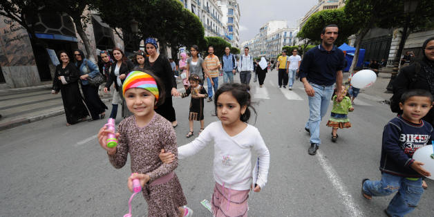 Algerian children with their families walk in Algiers' main street of Didouch Mourad on May 16, 2008 as the local municipality authorities called for a 'day without vehicles' in the capital's center. The municipality asked residents to walk, bike and ride on public transport instead of driving cars for reducing pollution. AFP PHOTO/FAYEZ NURELDINE (Photo credit should read FAYEZ NURELDINE/AFP/Getty Images)