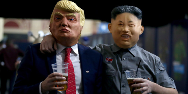 Fans dressed as President of the United States Donald Trump and leader of North Korea Kim Jong-un during day three of the William Hill World Darts Championship at Alexandra Palace, London. (Photo by Steven Paston/PA Images via Getty Images)