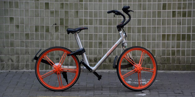 Mobike bicycles parked on a sidewalk in Jing'an district, Shanghai, a popular, new bike sharing rental online service system.