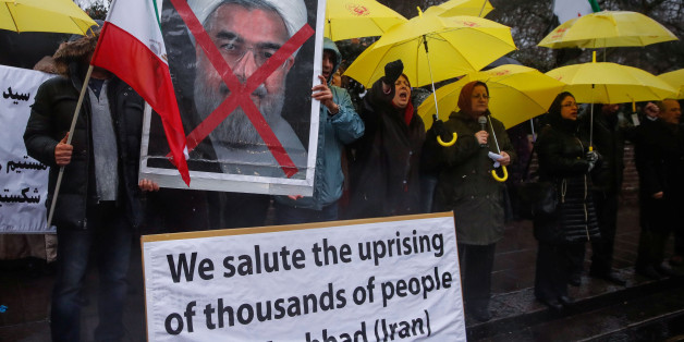Opponents of Iranian President Hassan Rouhani hold a protest outside the Iranian embassy in west London, December 31, 2017.  REUTERS/Eddie Keogh