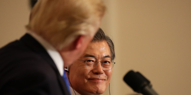 U.S. President Donald Trump, left, looks at Moon Jae-in, South Korea's president, during a news conference at the presidential Blue House in Seoul, South Korea, on Tuesday, Nov. 7, 2017. Trump said that North Korea should come to the table and make a deal on its missile and nuclear programs. Photographer: SeongJoon Cho/Bloomberg via Getty Images