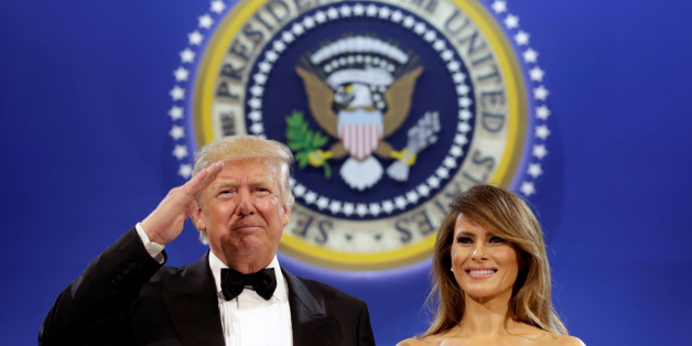 U.S. President Donald Trump salutes with his wife Melania at the Armed Services Ball in Washington, U.S., January 20, 2017. REUTERS/Yuri Gripas