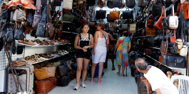 Russian tourists are seen shopping at the old medina in Sousse, Tunisia, September 30, 2017. Picture taken September 30, 2017. REUTERS/Zoubeir Souissi
