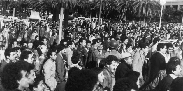 Picture released on January 5, 1984 shows Tunisian people gathering in the streets of Tunis after Tunisian president Habib Bourguiba appeared on radio and television to announce a new budget to avoid excessive price increases for food staples and that price rises would be rescinded. Violent protest demonstrations against the increase in the price of bread and basic food products, the 'Tunisian Bread riots', began on January 1, 1984 when price rises were officially announced and a state of emerge
