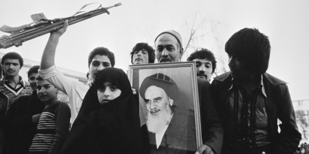 Citizens hold a portrait of Ruhollah Khomeini during a pro-Khomeini demonstration in Tehran. (Photo by Christine Spengler/Sygma/Sygma via Getty Images)