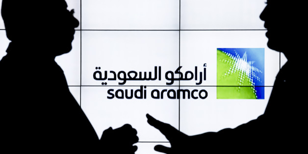 A Saudi Arabian Oil Co. (Aramco) logo sits on an electronic display at the company's corporate pavilion during the 22nd World Petroleum Congress in Istanbul, Turkey, on Wednesday, July 12, 2017. Oilfell from the lowest closing price in two weeks as talk of Libya and Nigeria being requested to cap their production failed to dispel doubts about the effectiveness of OPECs cut. Photographer: Kostas Tsironis/Bloomberg via Getty Images