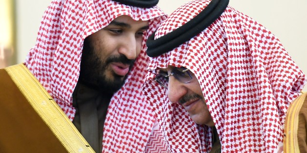 Saudi Defence Minister Mohamed bin Salman (L) talks with Crown Prince and Interior Minister Mohammed bin Nayef during the 136th Gulf Cooperation Council (GCC) summit, in the Saudi capital Riyadh, on December 9, 2015. Gulf monarchs began arriving in Saudi Arabia for an annual summit, facing challenges including plunging oil revenues, the war in Yemen, pressure for peace in Syria and signs of regional divisions.  / AFP / FAYEZ NURELDINE        (Photo credit should read FAYEZ NURELDINE/AFP/Getty Im