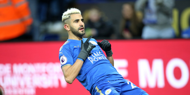 LEICESTER, ENGLAND - JANUARY 01: Riyad Mahrez of Leicester City celebrates after scoring to make it 1-0 during the Premier League match between Leicester City and Huddersfield at King Power Stadium on January 1st , 2018 in Leicester, United Kingdom.  (Photo by Plumb Images/Leicester City FC via Getty Images)