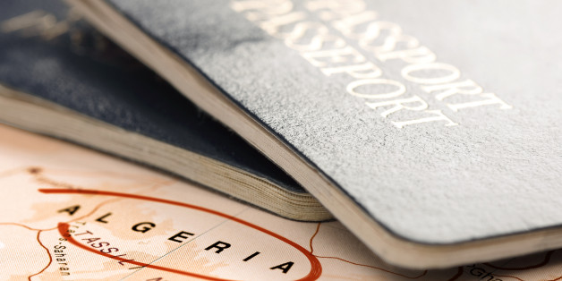 Algeria, destination marked with red color. Two passports on the map are ready for travel. The map is toned in pastel colors. Concept: Planning travel destinations or journey planning. Close-up view. Studio shot. Landscape orientation.