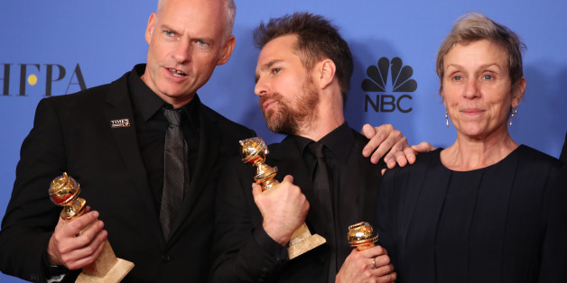 """75th Golden Globe Awards – Photo Room – Beverly Hills, California, U.S., 07/01/2018 – Martin McDonagh (L), winner for Best Screenplay - Motion Picture, Sam Rockwell, winner for Best Performance By An Actor In A Supporting Role In Any Motion Picture, and Frances McDormand, winner for Best Performance By An Actress In A Motion Picture - Drama, pose backstage after also winning the award for Best Motion Picture - Drama for """"Three Billboards Outside Ebbing, Missouri."""" REUTERS/Lucy Nic"""