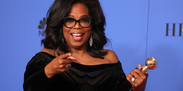 75th Golden Globe Awards – Photo Room – Beverly Hills, California, U.S., 07/01/2018 – Oprah Winfrey poses backstage with her Cecil B. DeMille Award. REUTERS/Lucy Nicholson