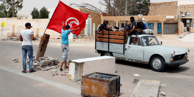 Protesters, who are demanding jobs and a share in revenue from the area's natural resources, react as they block the road which is usually used by foreign oil companies to go the oilfield in Tataouine, Tunisia May 12, 2017. Picture taken May 12, 2017. REUTERS/Zoubeir Souissi     TPX IMAGES OF THE DAY