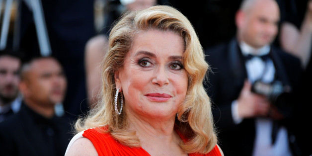 70th Cannes Film Festival - Event for the 70th Anniversary of the festival - Red Carpet Arrivals - Cannes, France. 23/05/2017. Actress Catherine Deneuve poses. REUTERS/Jean-Paul Pelissier