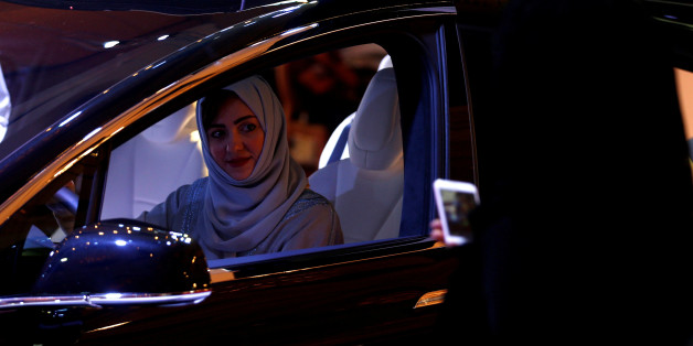 A Saudi woman is photographed as she checks a car at a showroom in Riyadh, Saudi Arabia October 5, 2017. REUTERS/Faisal Al Nasser     TPX IMAGES OF THE DAY