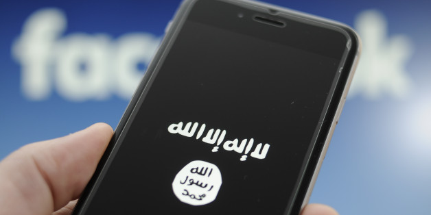 The sumbol for the terrorist ISIS or Daesh organisation is seen on a smartphon in this photo illustration on December 4, 2017. (Photo by Jaap Arriens/NurPhoto via Getty Images)