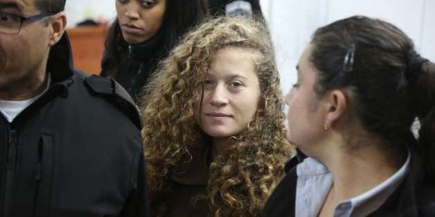 RAMALLAH, WEST BANK - JANUARY 01: The 16-year-old Palestinian Ahed al-Tamimi (2nd R), who was awarded the 'Hanzala Award for Courage' in Turkey, appears in court after she was taken into custody by Israeli soldiers, at Ofer Military Court in Ramallah, West Bank on January 01, 2018. (Photo by Issam Rimawi/Anadolu Agency/Getty Images)