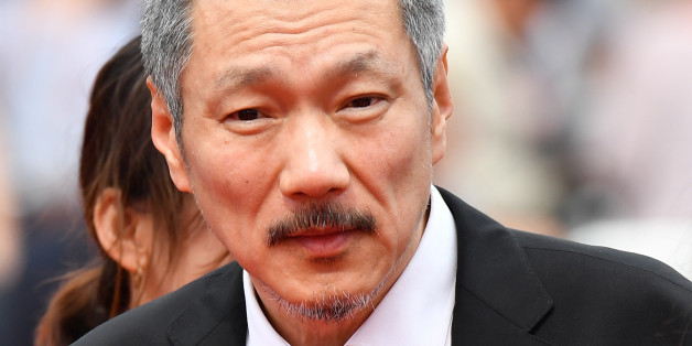 South Korean director Hong Sangsoo arrives on May 22, 2017 for the screening of the film 'Geu-Hu' (The Day After) at the 70th edition of the Cannes Film Festival in Cannes, southern France.  / AFP PHOTO / Alberto PIZZOLI        (Photo credit should read ALBERTO PIZZOLI/AFP/Getty Images)