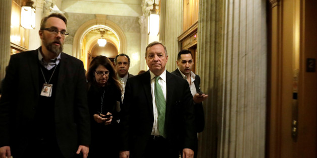 Senator Dick Durbin (D-IL) (C) arrives at Democratic Party caucus meeting on Capitol Hill in Washington, U.S., January 19, 2018. REUTERS/Yuri Gripas