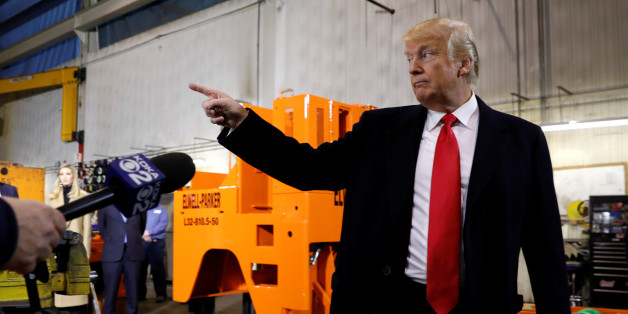 U.S. President Donald Trump gestures during a visit to H&K Equipment Company in Coraopolis, Pennsylvania, U.S., January 18, 2018. REUTERS/Kevin Lamarque