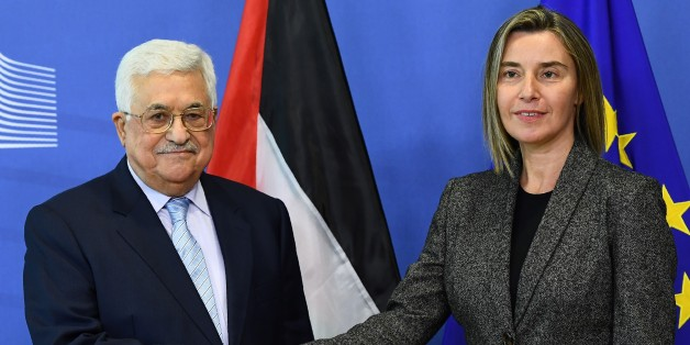 Palestian President Mahmoud Abbas (L) is welcomed by EU foreign policy chief Federica Mogherini prior to a meeting at the European Commission in Brussels on March 27, 2017. / AFP PHOTO / EMMANUEL DUNAND        (Photo credit should read EMMANUEL DUNAND/AFP/Getty Images)