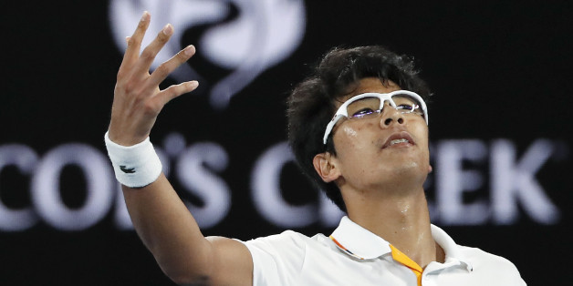 Tennis - Australian Open - Rod Laver Arena, Melbourne, Australia, January 22, 2018. Chung Hyeon of South Korea gestures to the crowd during his match against Novak Djokovic of Serbia. REUTERS/Issei Kato
