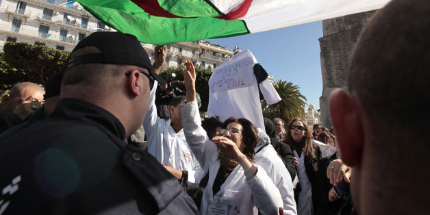 Medical staff chant slogans during a protest rally near the government palace in Algiers February 17, 2010. Thousands of Algerian public sector doctors went on strike, and have been holding regular protest rallies, to demand for an improvement in their terms of employment. REUTERS/Zohra Bensemra (ALGERIA - Tags: POLITICS HEALTH CIVIL UNREST EMPLOYMENT BUSINESS)