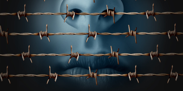 Concept of censorship and freedom of speech crisis symbol and suppression in expression of ideas icon as a human behind in old barbed wire as a metaphor for depression and social isolation in a 3D illustration style.