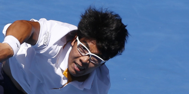 Tennis - Australian Open - Quarterfinals - Rod Laver Arena, Melbourne, Australia, January 24, 2018. Chung Hyeon of South Korea serves against Tennys Sandgren of the U.S. REUTERS/Toru Hanai