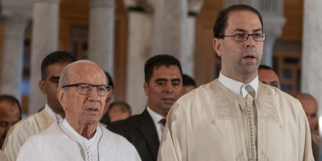CARTHAGE, TUNISIA - SEPTEMBER 12: Tunisian President Beji Caid Essebsi (L) and Tunisian Prime Minister Youssef Chahed (R) arrive to perform the Eid Al-Adha (Feast of Sacrifice) prayer at Malik ibn Anas Mosque in Carthage, Tunisia on September 12, 2016. Muslims worldwide celebrate Eid Al-Adha, to commemorate the holy Prophet Ibrahim's (Prophet Abraham) readiness to sacrifice his son as a sign of his obedience to God, during which they sacrifice permissible animals, generally goats, sheep, and