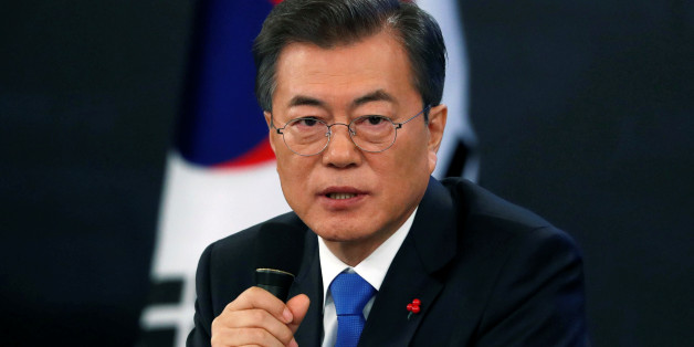 South Korean President Moon Jae-in answers reporters' question during his New Year news conference at the Presidential Blue House in Seoul, South Korea, January 10, 2018.  REUTERS/Kim Hong-Ji
