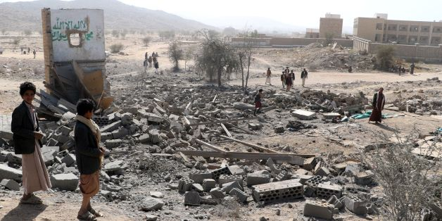 Yemenis inspect damage at the site of a reported air strike by the Saudi-led coalition, on the outskirts of the northwestern Huthi-held Saada province, on January 22, 2018. / AFP PHOTO / STRINGER        (Photo credit should read STRINGER/AFP/Getty Images)