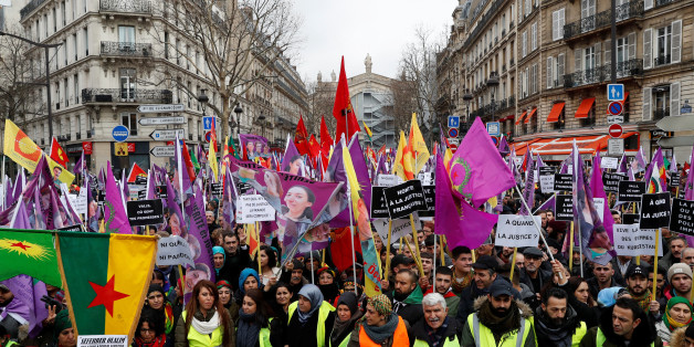 Pro-Kurdish protesters attend a demonstration against the Turkish president's visit to Paris and to urge French authorities to find those responsible for the killing of three Kurdish activists in Paris, France, January 6, 2018. REUTERS/Gonzalo Fuentes