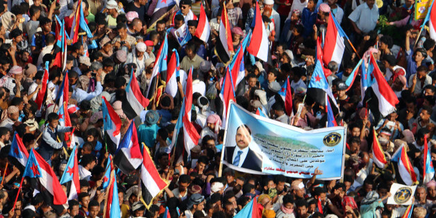 Yemeni supporters of the southern separatist movement wave the movement's flag during a rally in the southern port city of Aden, on October 14, 2017. / AFP PHOTO / STRINGER        (Photo credit should read STRINGER/AFP/Getty Images)