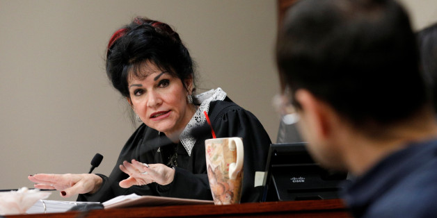 Circuit Court Judge Rosemarie Aquilina addresses Larry Nassar, (R) a former team USA Gymnastics doctor, who pleaded guilty in November 2017 to sexual assault charges, during his sentencing hearing in Lansing, Michigan, U.S., January 18, 2018. REUTERS/Brendan McDermid