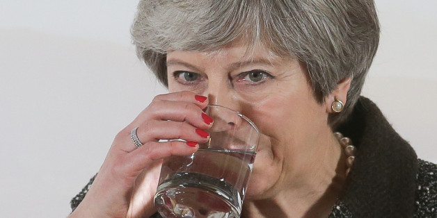 Britain's Prime Minister Theresa May drinks from her glass of water as she gives a speech on the environment in London on January 11, 2018.Campaigners on January 11 criticised British Prime Minister Theresa May's plan to eliminate all avoidable plastic waste within 25 years, calling it a 'missed opportunity' that lacked the necessary urgency. The government will extend a charge on plastic bags to all businesses and encourage supermarkets to introduce plastic-free aisles, May said in speech. / AF
