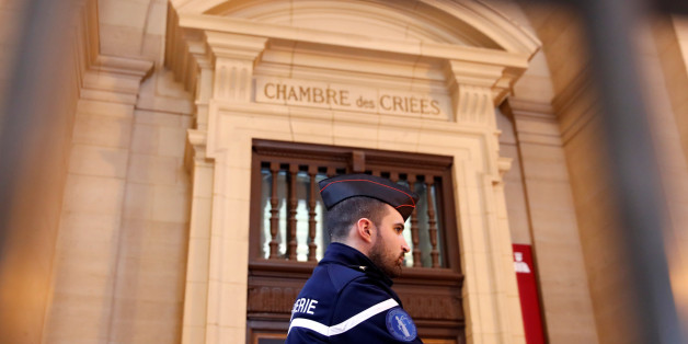 A French gendarme waits for the start of the trial of Jawad Bendaoud, the man accused of housing the suspected planner of the November 2015 attacks, at the courts in Paris, France, January 24, 2018.   REUTERS/Christian Hartmann