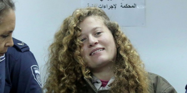 RAMALLAH, WEST BANK - JANUARY 17: The 16-year-old Palestinian Ahed al-Tamimi, who was awarded the 'Hanzala Award for Courage' in Turkey, appears in court at Ofer Military Court in Ramallah, West Bank on January 17, 2018. The Israeli court on Wednesday extended the detention of 16-year-old Palestinian girl Ahed al-Tamimi until January 31, for the fifth time since her arrest.  (Photo by Issam Rimawi/Anadolu Agency/Getty Images)