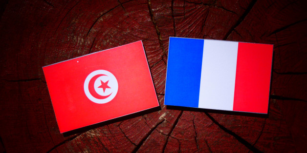 Tunisian flag with French flag on a tree stump isolated