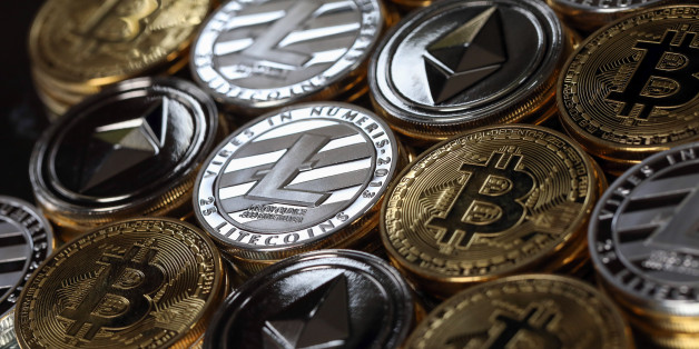 A collection of bitcoin, litecoin and ethereum tokens sit in this arranged photograph in Danbury, U.K., on Tuesday, Oct. 17, 2017. On Wednesday, billionaireWarren Buffettsaid on CNBC that most digital coins won't hold their value. Photographer: Chris Ratcliffe/Bloomberg via Getty Images