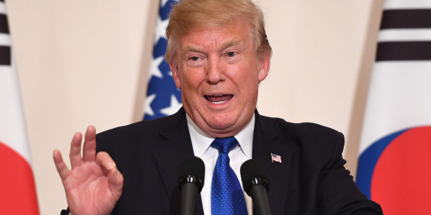 US President Donald Trump gestures during a joint press conference with South Korea's President Moon Jae-In at the presidential Blue House in Seoul on November 7, 2017.US President Donald Trump arrived in Seoul on November 7 vowing to 'figure it all out' with his South Korean counterpart Moon Jae-In, despite the two allies' differences on how to deal with the nuclear-armed North. / AFP PHOTO / Jim WATSON        (Photo credit should read JIM WATSON/AFP/Getty Images)