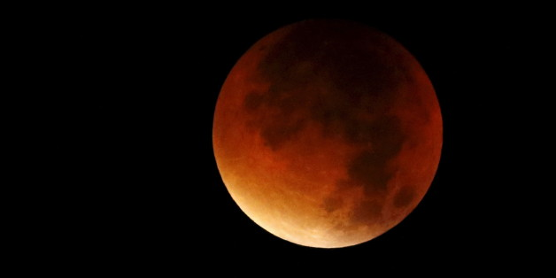 "A supermoon is seen in the sky in Colmar, France, September 28, 2015. Sky-watchers around the world were treated when the shadow of Earth cast a reddish glow on the moon, the result of rare combination of an eclipse with the closest full moon of the year. The total ""supermoon"" lunar eclipse, also known as a ""blood moon"" is one that appears bigger and brighter than usual as it reaches the point in its orbit that is closest to Earth. REUTERS/Jacky Naegelen"