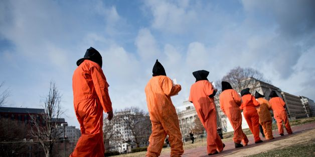 Activists protest the Guantanamo Bay detention camp during a rally in Lafayette Square outside the White House January 11, 2018 in Washington, DC. / AFP PHOTO / Brendan Smialowski        (Photo credit should read BRENDAN SMIALOWSKI/AFP/Getty Images)