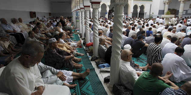 Worshippers attend morning prayers of Eid al-Fitr holiday, marking the end of the holy month of Ramadan, at al Biar mosque in Algiers, Algeria, July 17, 2015.REUTERS/Ramzi Boudina