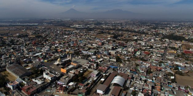 Aerial view of the municipality of Tenancingo, Tlaxcala state, Mexico with the Popocatepetl volcano in the background, on January 19, 2018. 
