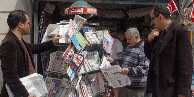 Tunisian people look at the stock of newspapers in a shop on May 03, 2008 in Tunis the international day for Press.  Reporters Without Borders (RSF) media rights group., said   'Freedom of expression remains a utopia in Tunisia. All the press does is glorify the work of President Zine El Abidine Ben Ali, and independent journalists and their families are the victims of constant harrassment,' . AFP PHOTO FETHI BELAID. (Photo credit should read FETHI BELAID/AFP/Getty Images)
