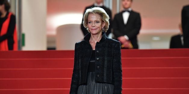 The President of the CNC Frederique Bredin looks at guests arriving on May 22, 2017 for the screening of the film 'Happy End' at the 70th edition of the Cannes Film Festival in Cannes, southern France.  / AFP PHOTO / Alberto PIZZOLI        (Photo credit should read ALBERTO PIZZOLI/AFP/Getty Images)