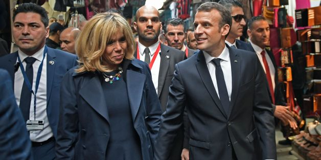 French President Emmanuel Macron (C-R) and his wife Brigitte (C-L) walk through the Medina (old town) of the Tunisian capital Tunis on February 1, 2018, during his first state visit to the North African country. / AFP PHOTO / POOL / Eric FEFERBERG        (Photo credit should read ERIC FEFERBERG/AFP/Getty Images)