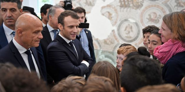 French President Emmanuel Macron attends a remembrance ceremony for the victims of a deadly Islamic State group attack in 2015 at Tunis' Bardo Museum on February 1, 2018. Macron on pledged support for Tunisia at an 'important moment' for its fragile democracy as he arrived on a first visit two weeks after protests rocked the country. / AFP PHOTO / Eric FEFERBERG        (Photo credit should read ERIC FEFERBERG/AFP/Getty Images)