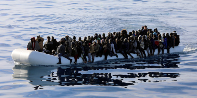 Migrants are seen in a rubber dinghy as they are rescued by Libyan coast guards in the Mediterranean Sea off the coast of Libya, January 15, 2018. Picture taken January 15, 2018. REUTERS/Hani Amara
