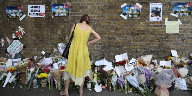 A woman looks at messages at the base of a wall near the scene of an attack next to Finsbury Park Mosque, in north London, Britain June 20, 2017. REUTERS/Marko Djurica